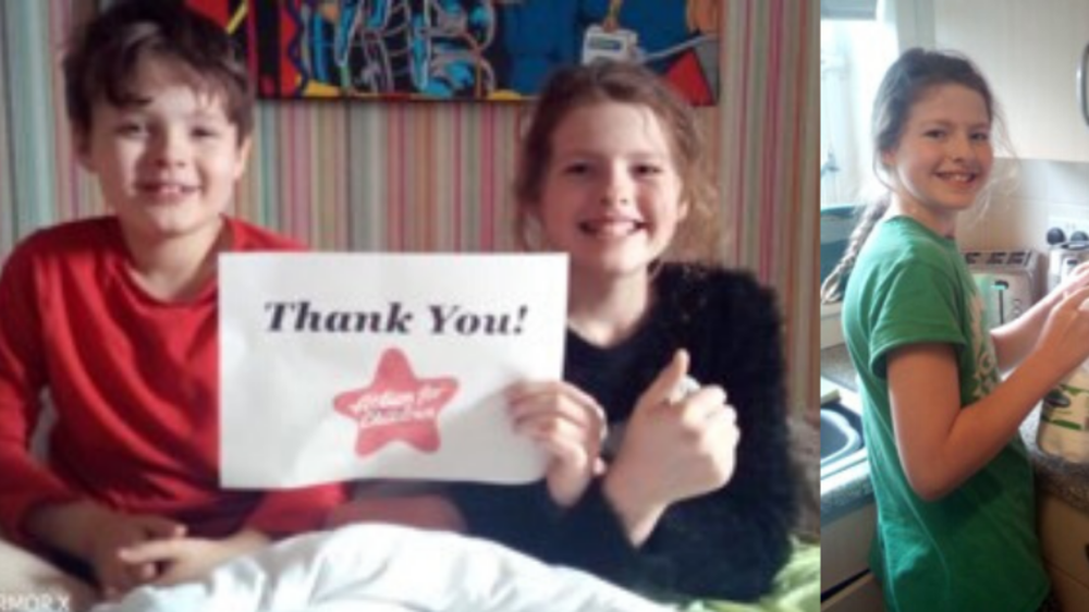 two children holding thank you sign.png