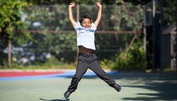 Happy boy star jump