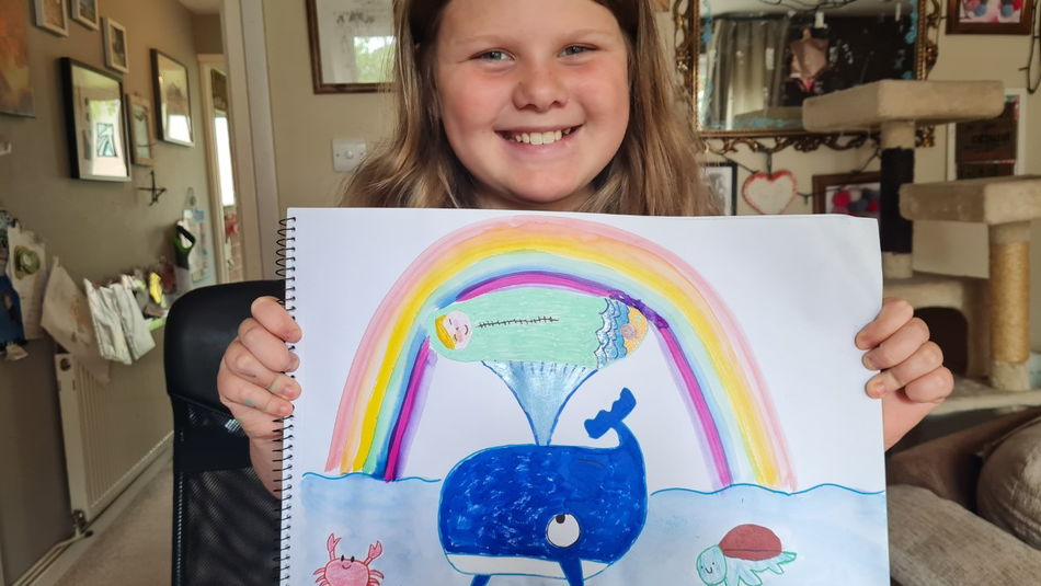Eliza shows off her Action for Children Drawing Challenge entry