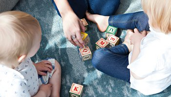 Family playing with letter blocks
