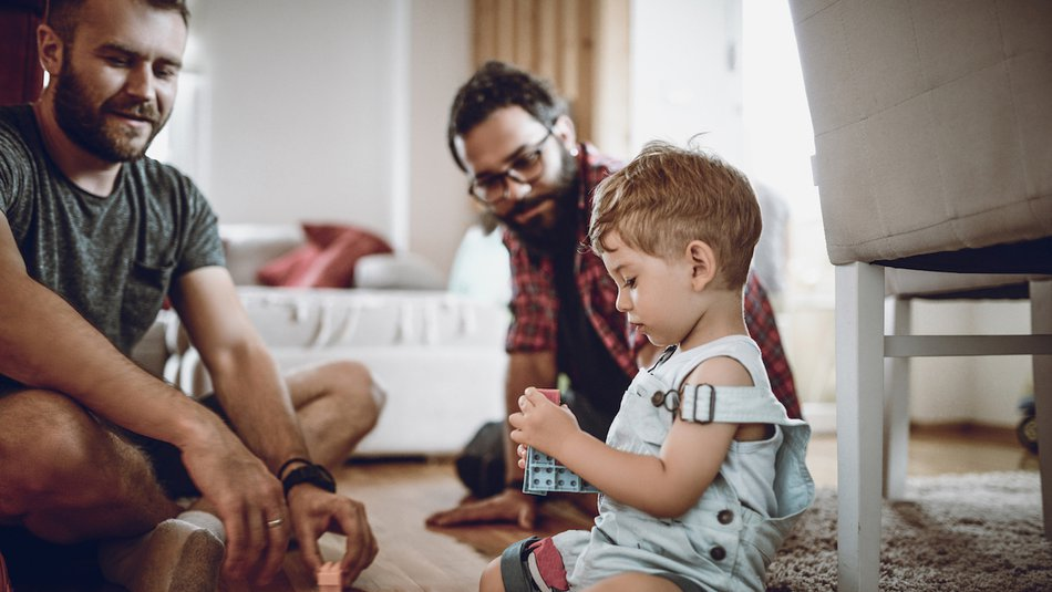 Gay fathers with child
