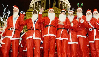 Group of men dressed as Santa for Santa in the City event