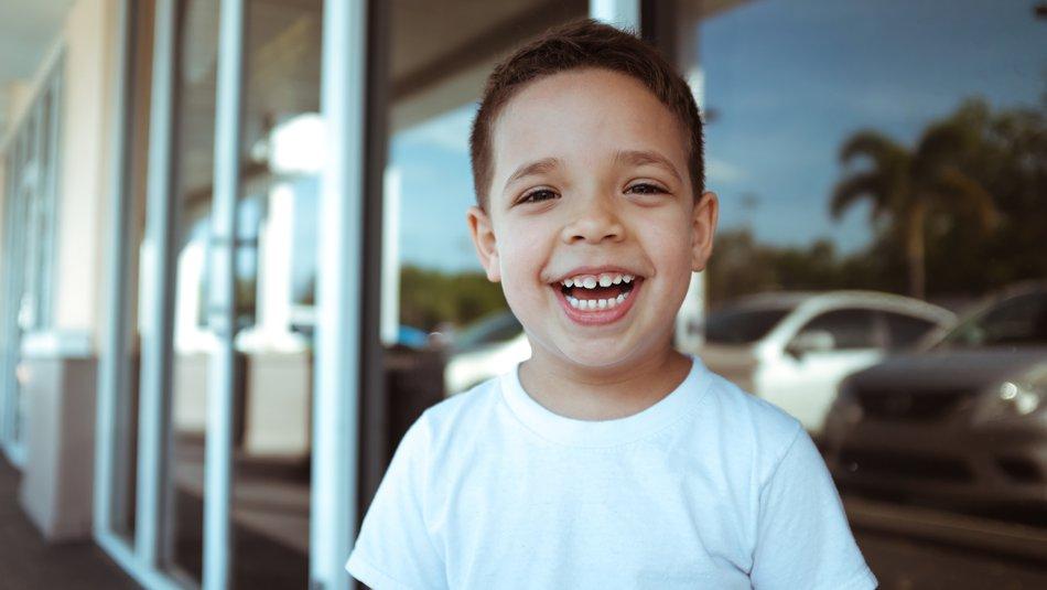 Happy boy smiling to camera