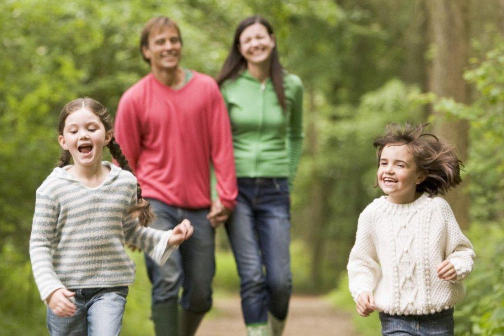 Happy family walking in woods