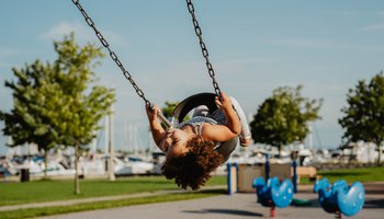 Joyful girl on swing