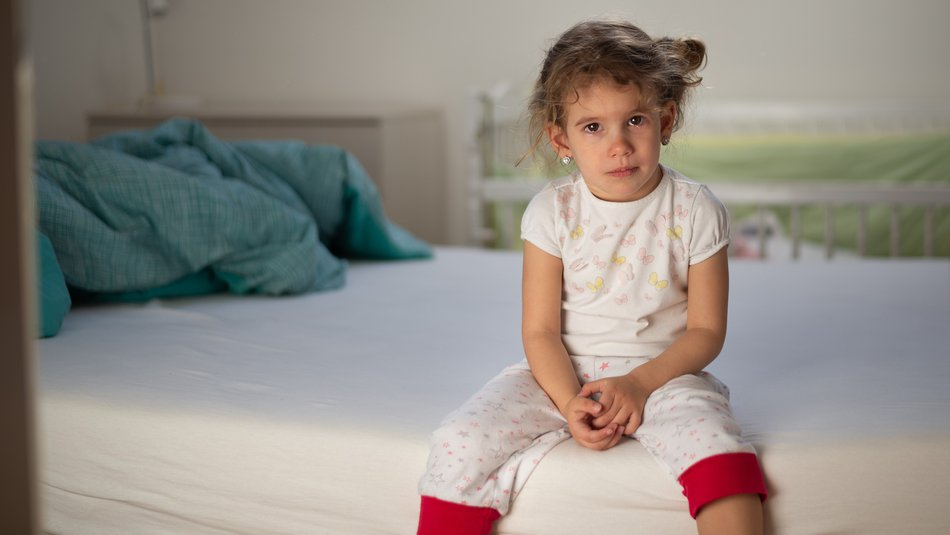 Little girl crying in bedroom
