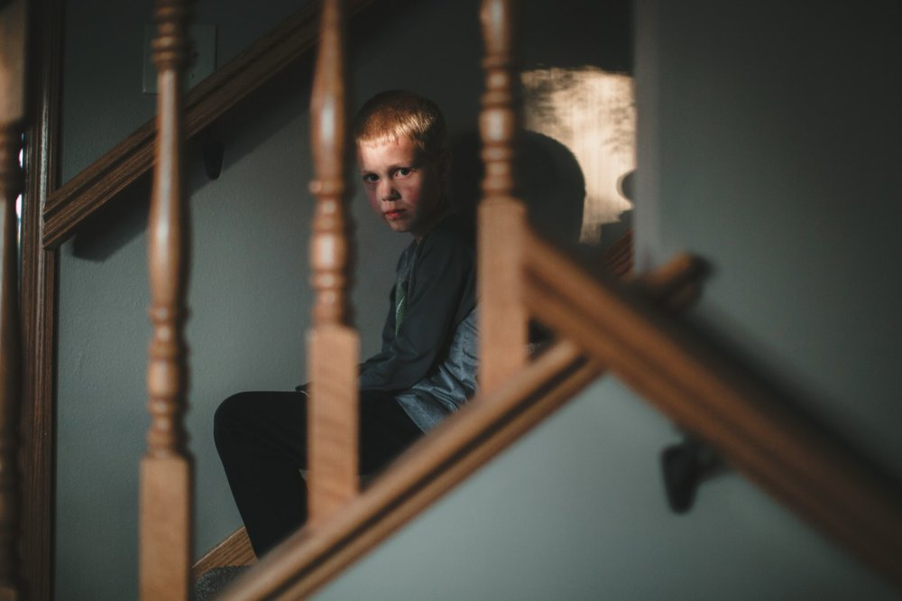 Scared boy on staircase