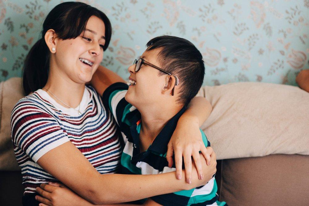 Siblings embracing
