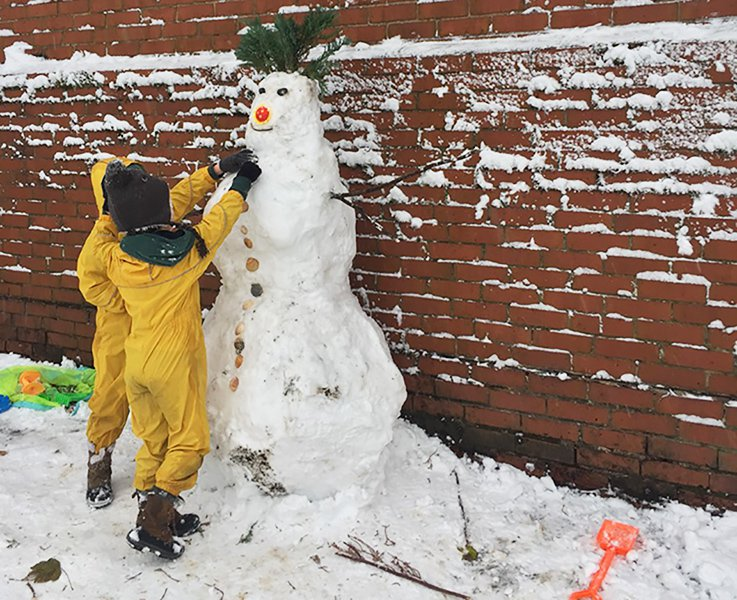 Small children playing in the snow
