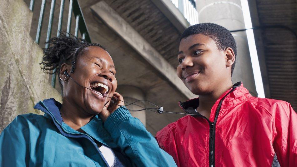 Teenage boy with mother on headphones