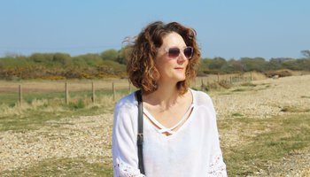 Woman with sunglasses on looking into the distance.jpg