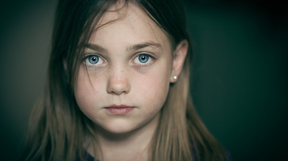 Worried young girl looking at camera.jpg
