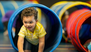 Young boy playing in play centre