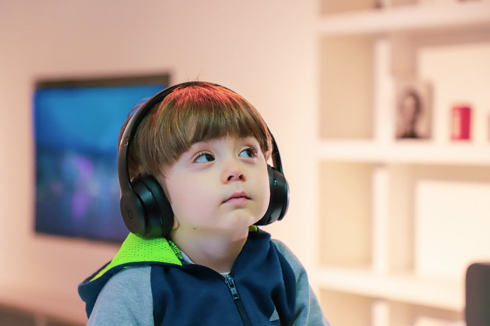 Young boy wearing large headphones