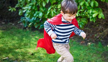Young boy with red cape