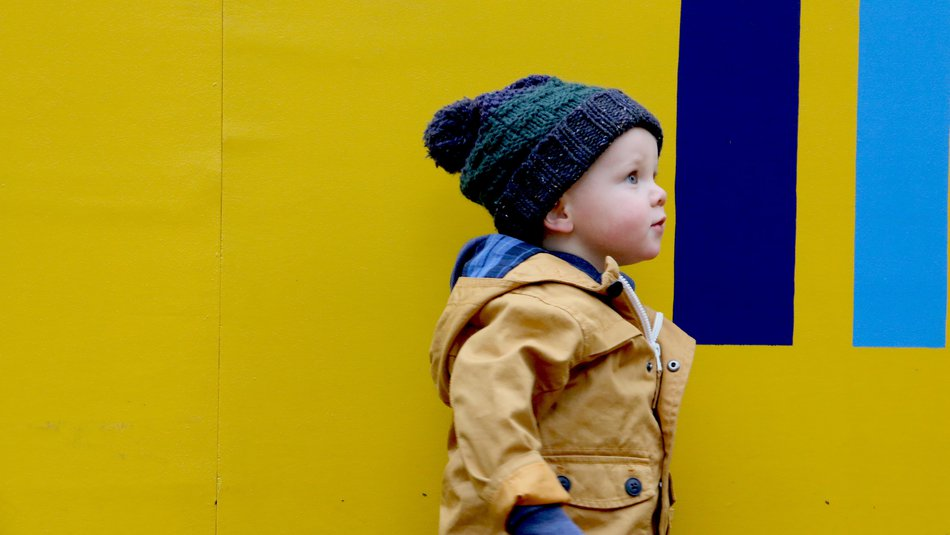 Young boy yellow background