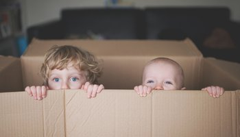 Young boys playing in box