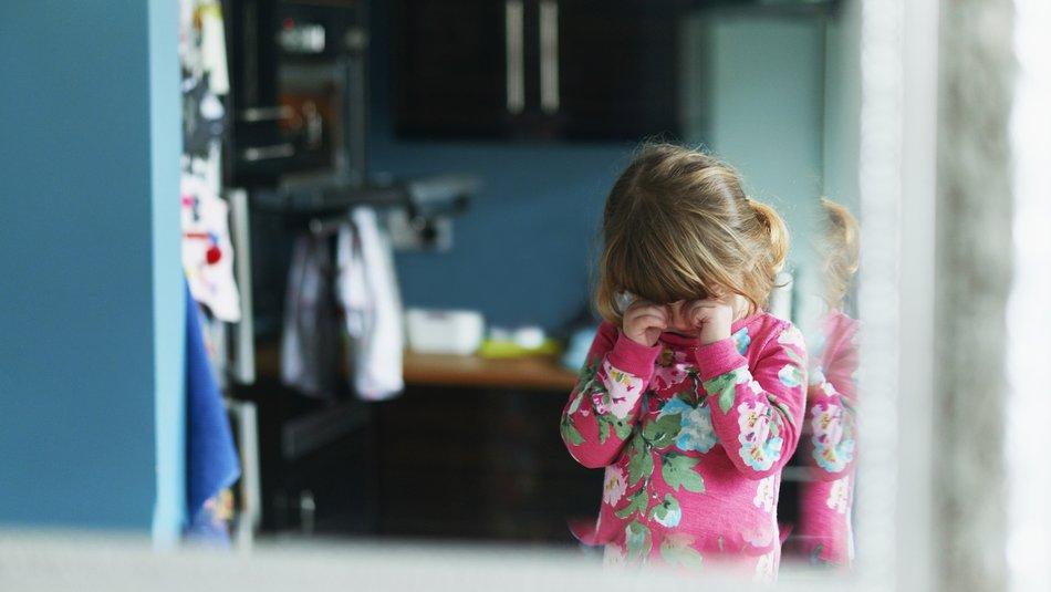 Young girl rubbing eyes