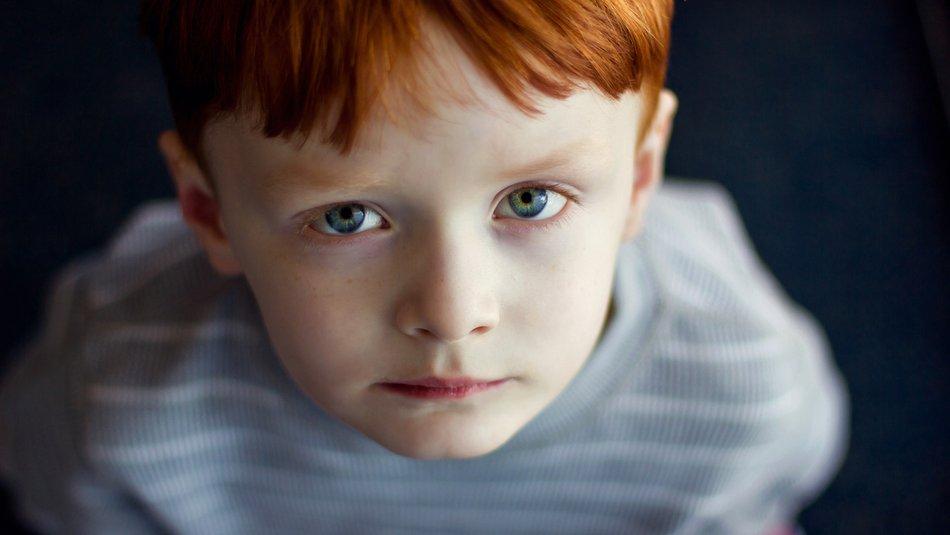 boy staring up at camera