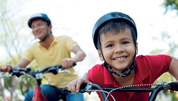 Young boy and his dad on bikes
