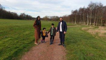 family standing in a park.jpg