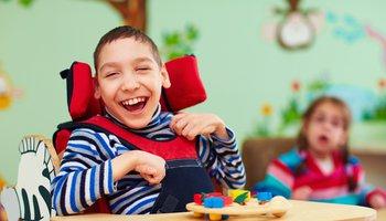 Happy boy in a wheelchair