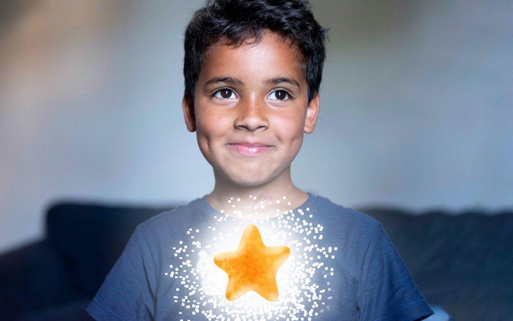Happy boy with star shining brightly