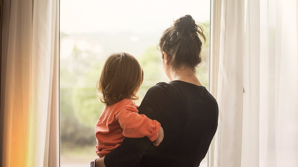 mother holding child looking out of window.jpg